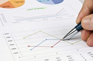 Male hand writing on financial report